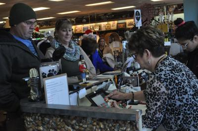 Cause for Paws volunteers help shoppers
