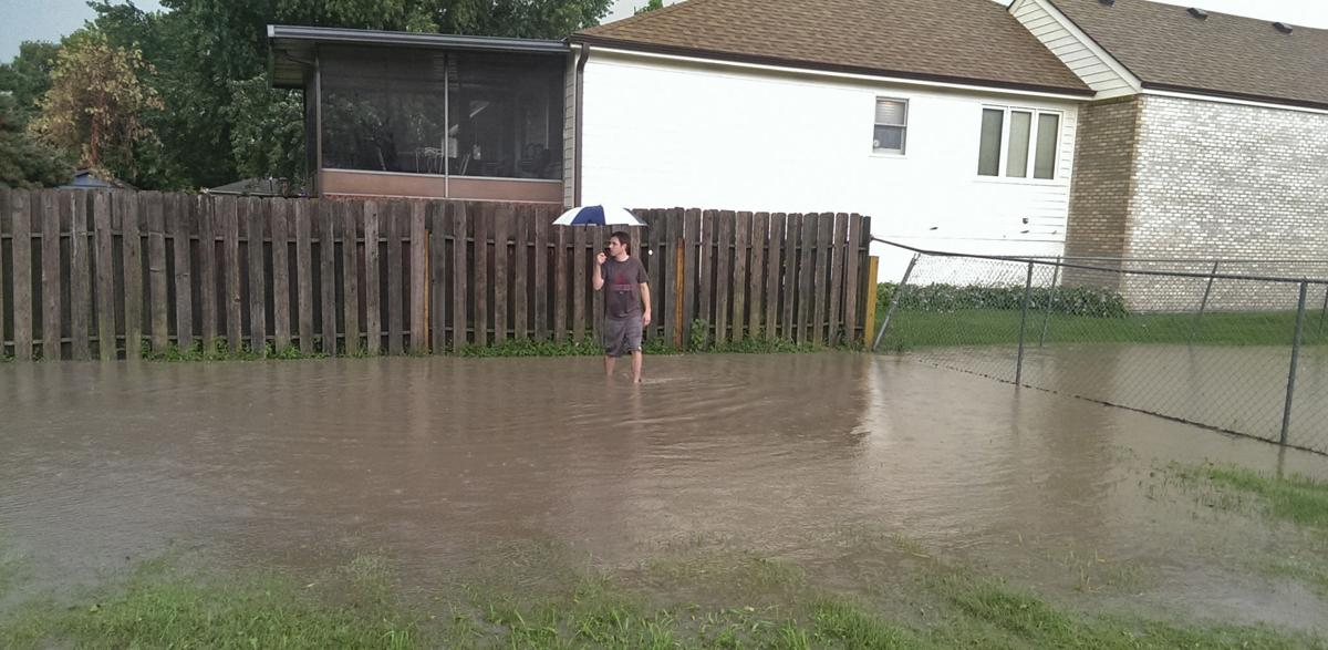 Residents beset with flooding problems after lps renovated for Yard flooding problems