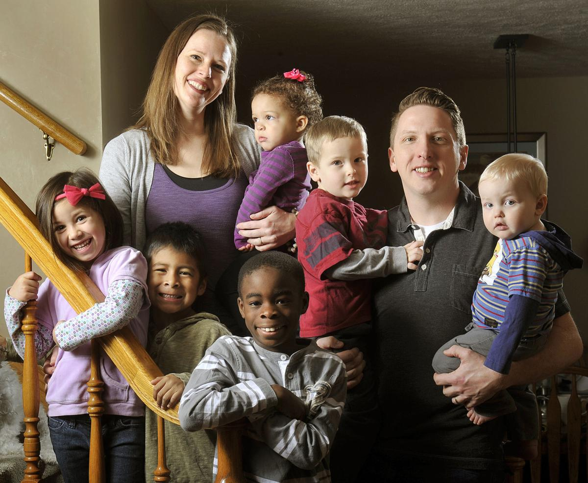 Black white baby family White Mother
