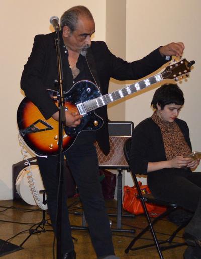 Gerardo Meza tunes his guitar