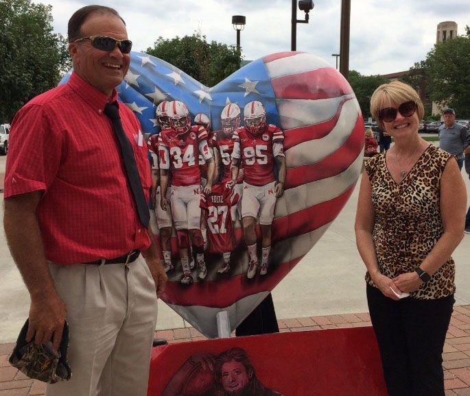 """Gerald and Jill Foltz, parents of Sam Foltz, unveil """"The Heart of the Huskers"""""""