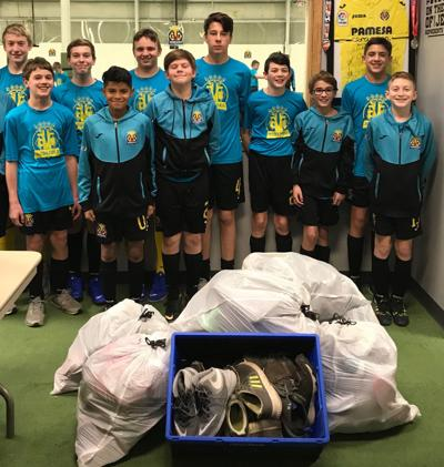 VNA soccer team with shoes for Haitian kids
