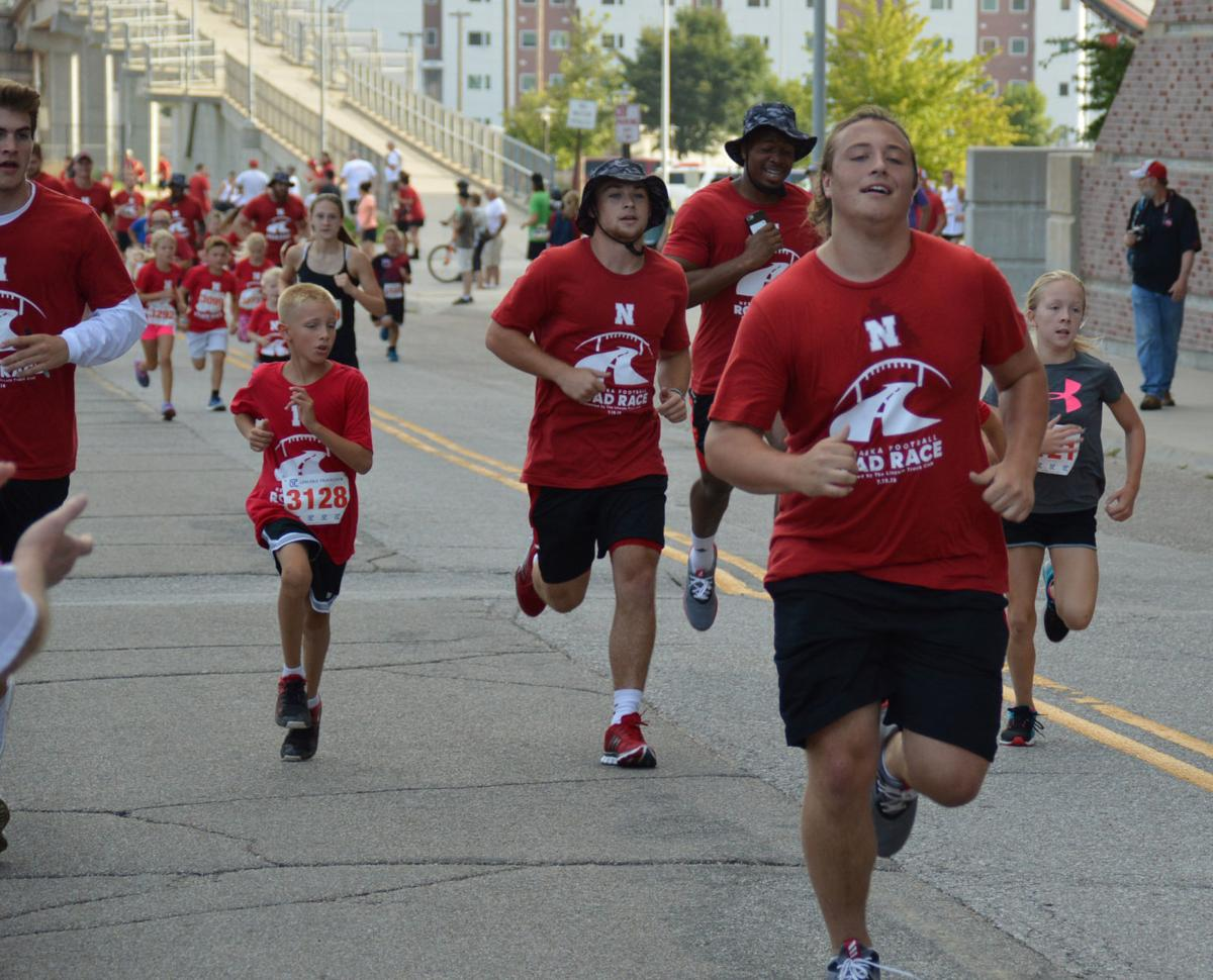 "Husker football players as ""running buddies"""