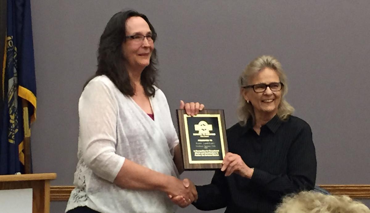 Karen Lamb receives Service to Mankind award