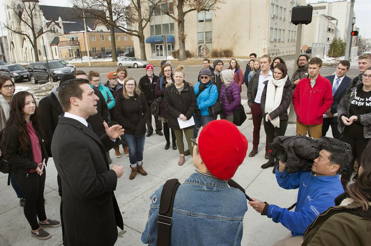 State Sen. Adam Morfeld of Lincoln speaks with students