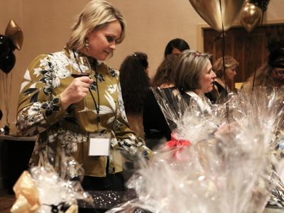 Amanda Dickson peruses auction items