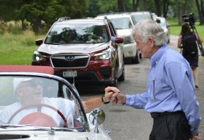 Car parade honors Bob Downey's retirement