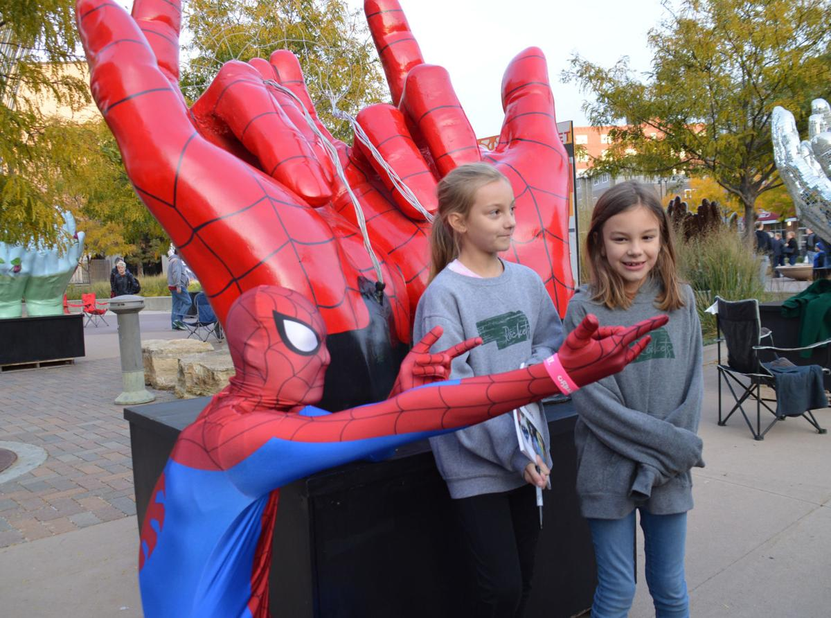 Spiderman (aka Charles Moravec Jr.) with sisters Grace and Lyla Badgett