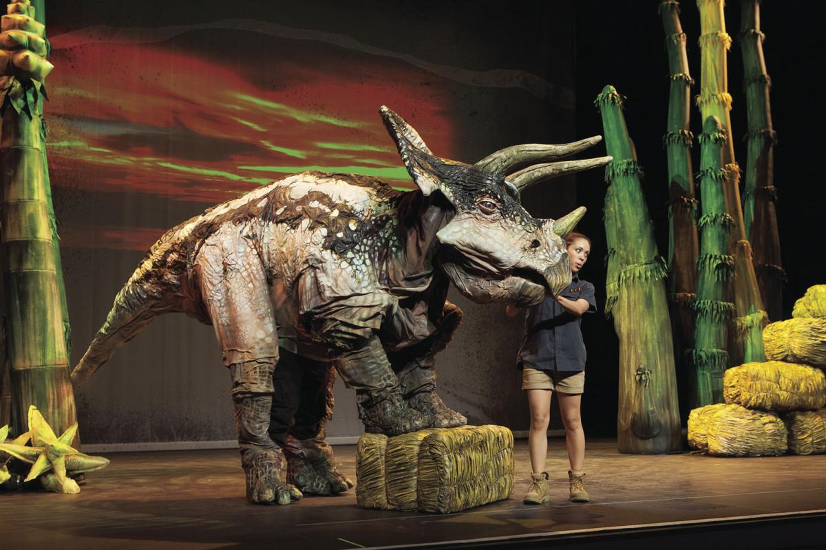 Aimee Louisanne and Triceratops at DINOSAUR ZOO LIVE. Photo by C. Waits