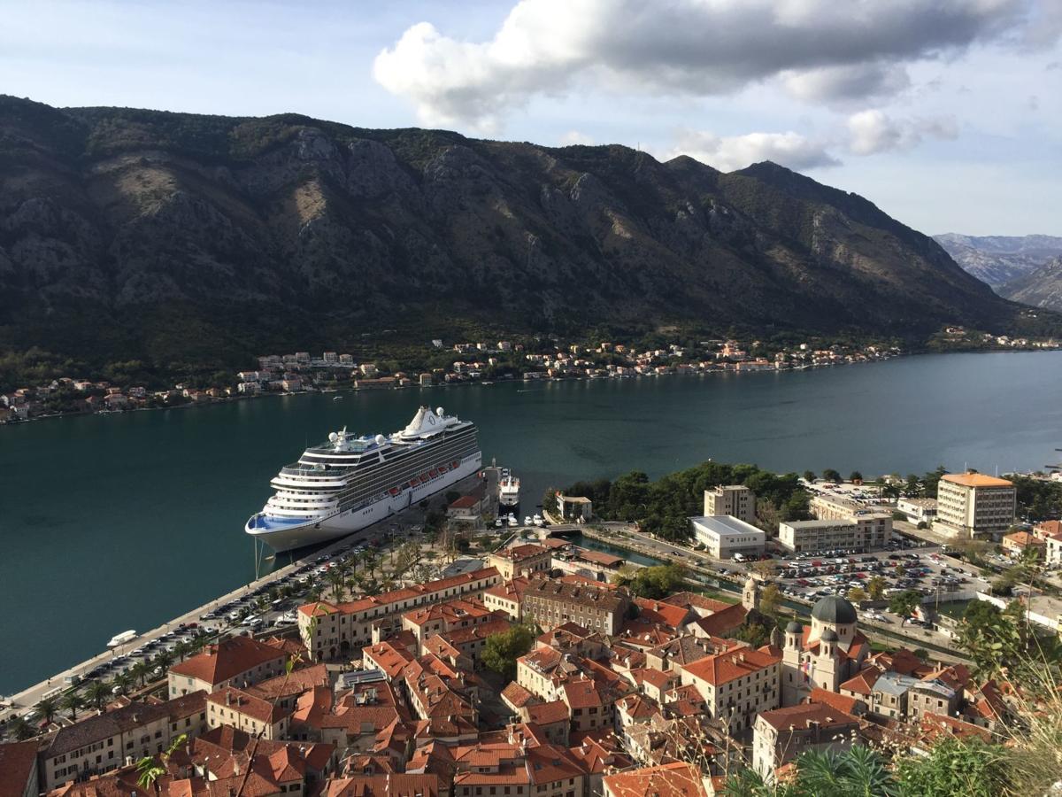 Riviera docked alongside the medevel city walls of kotor montenegro