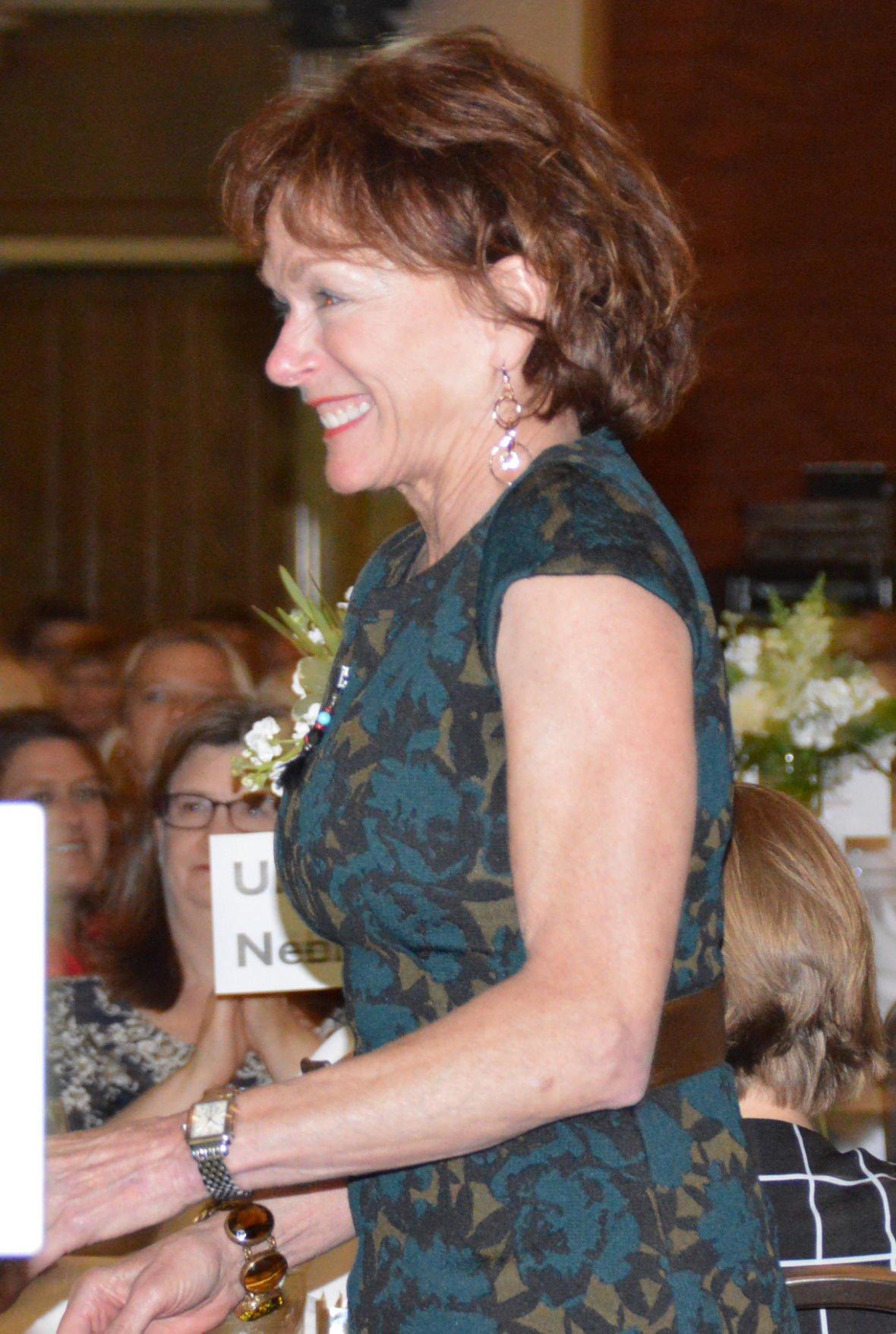 Kathy LeBaron walks up to stage
