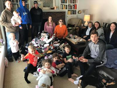Ludvik family counts number of shoes collected