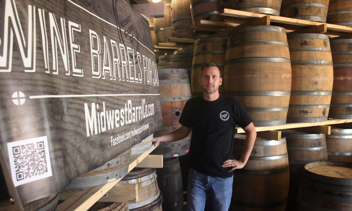 stacked oak barrels maturing red wine. Midwest Barrel Company Stacked Oak Barrels Maturing Red Wine