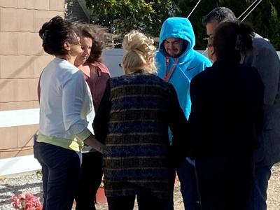 Family members pray in alleyway where Brett Torres was killed