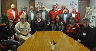 Sowers with nonprofit representatives