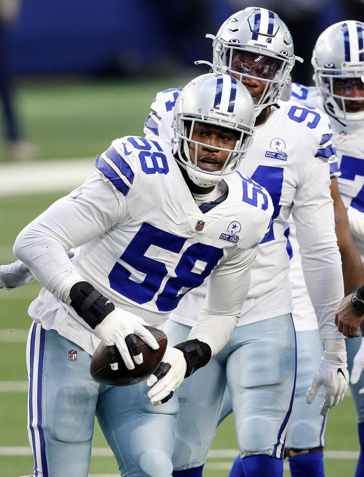 Dallas Cowboys defensive end Aldon Smith comes up with a first quarter fumble against the San Francisco 49 ers on Sunday, Dec. 20, 2020 at AT&T Stadium in Arlington, Texas.