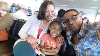Alicia Campbell, Devin James and their daughter