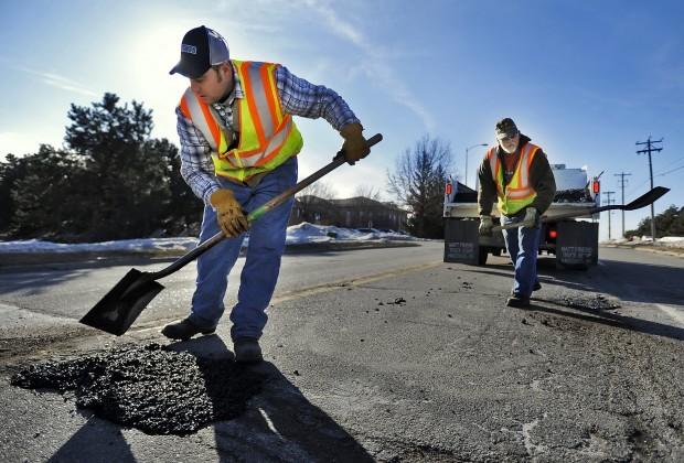 Image result for filling potholes in winter