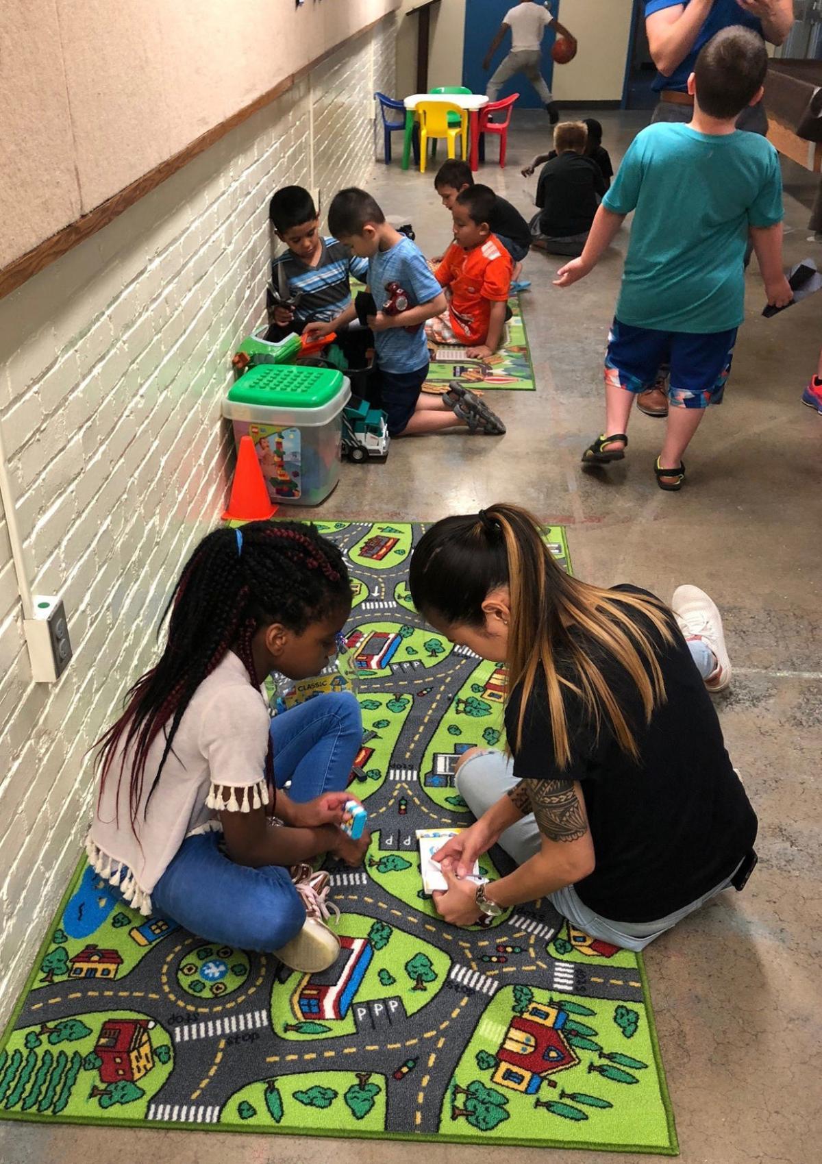 Kids play on activity mats