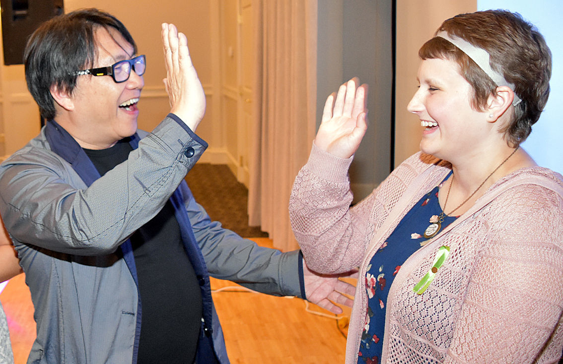 Dr. Chiu high five with Gracie Reese