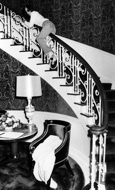 Ruth Thone, sliding down banister