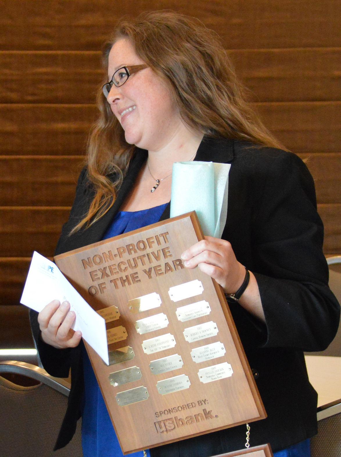 Monica Zinke receives her plaque