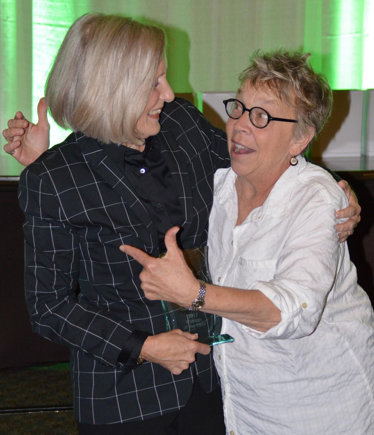 Barbara Bartle congratulated by T. Marni Vos