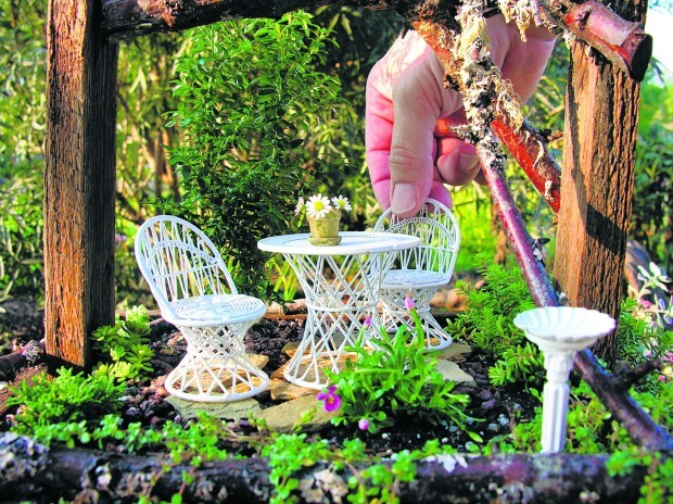 Small Pieces Of Outdoor Furniture Enhance The Ambiance Of A Miniature Garden.  (Courtesy Landscapes In Miniature/MCT)