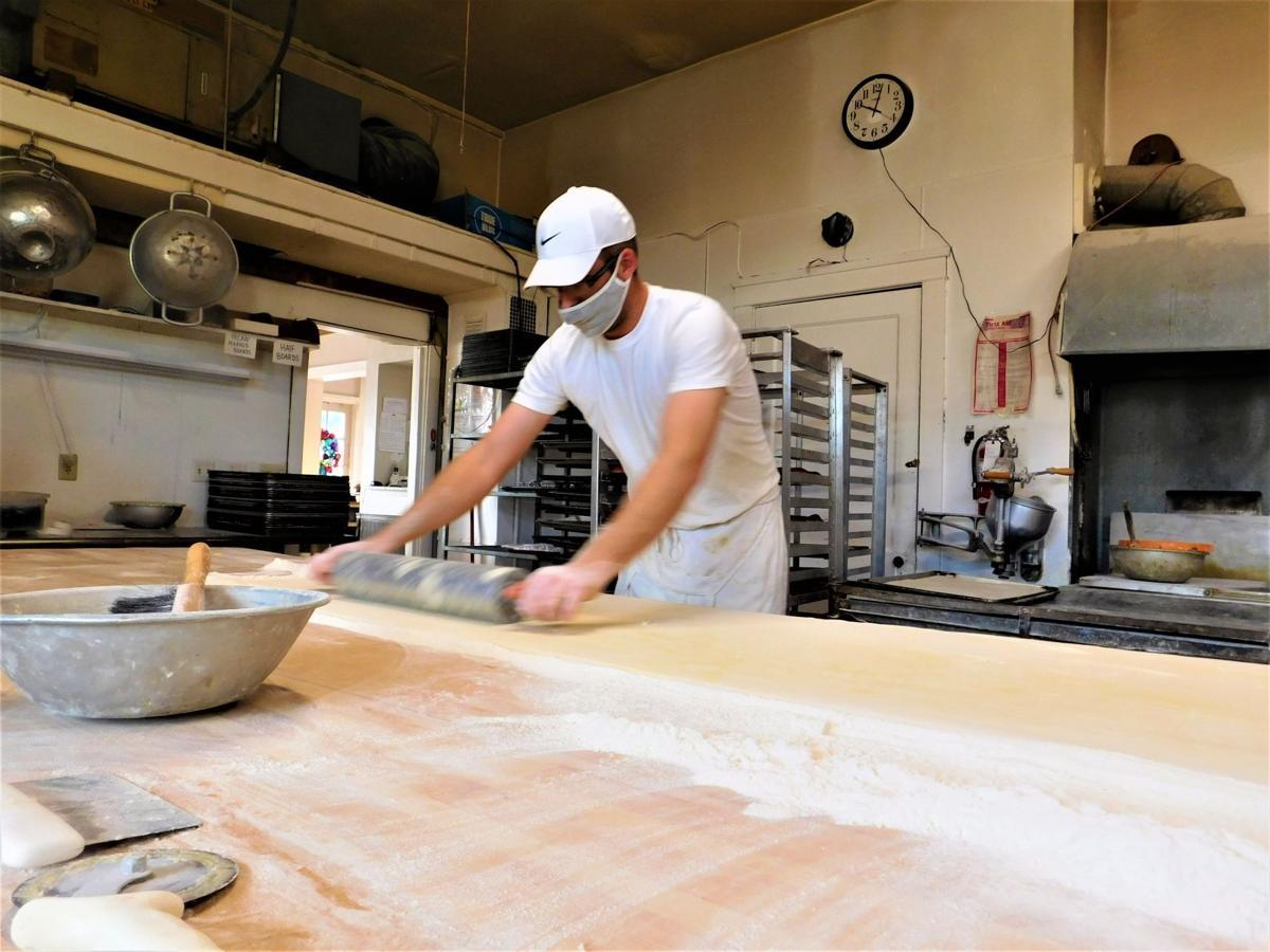 """Bendt """"Ben"""" Bendtsen III handrolling kringle dough at Bendtsen's Bakery"""