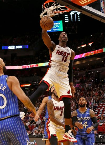 Miami Heat forward Bam Adebayo (13) dunks in the first quarter against the Orlando Magic at the AmericanAirlines Arena in Miami on March 26, 2019.