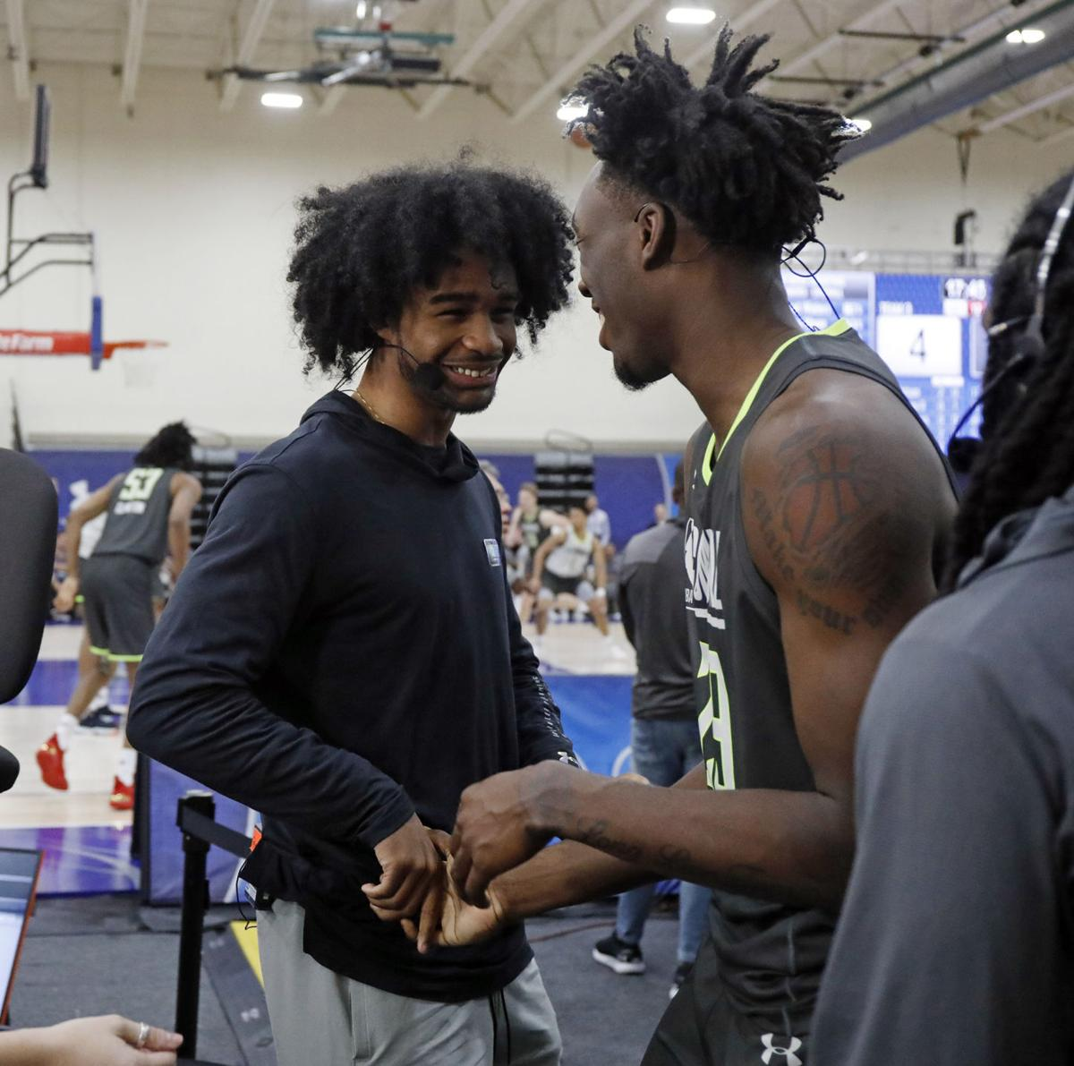 North Carolina teammates Coby White and Nassir Little greet each other during the NBA draft combine on Thursday, May 16, 2019 at the Quest Multisport Complex in Chicago, Ill.