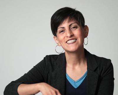 Esther J. Cepeda.