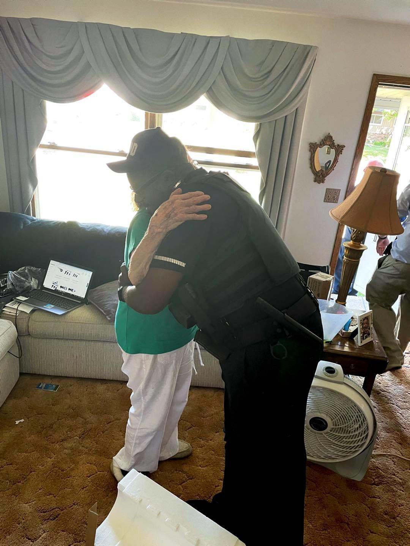 Myles Barry gives a woman a hug