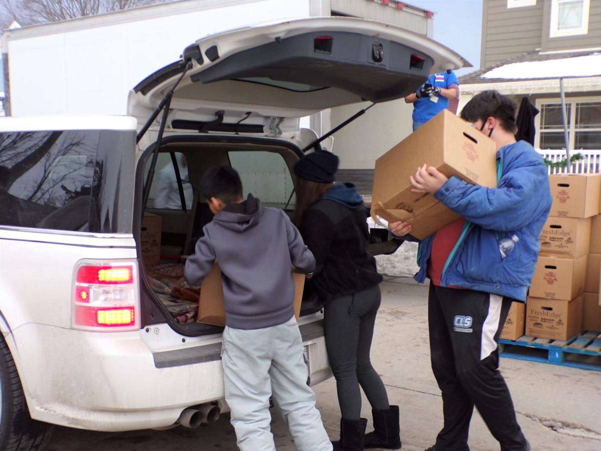 Volunteers load up a car