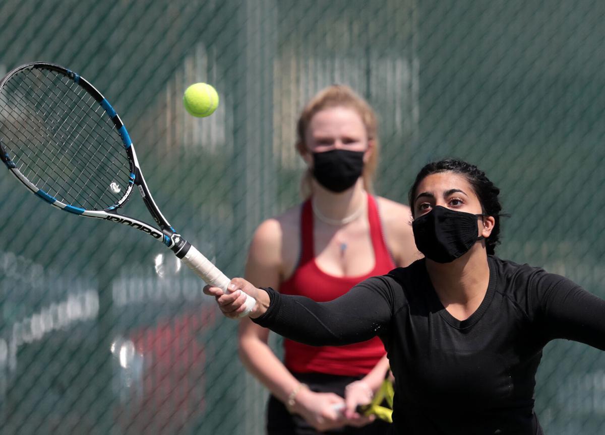 WIAA girls tennis photo: Middleton seniors Noor Rajpal, front, and Karsen Dettman