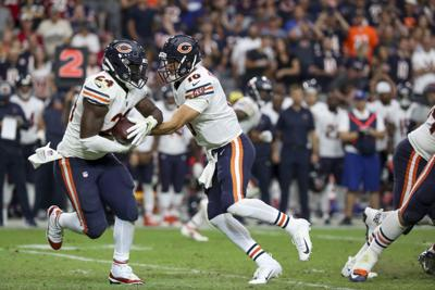 Chicago Bears quarterback Mitch Trubisky (10) hands off to running back Jordan Howard (24) during the second half against the Arizona Cardinals on September 23, 2018, at State Farm Stadium in Glendale, Ariz.