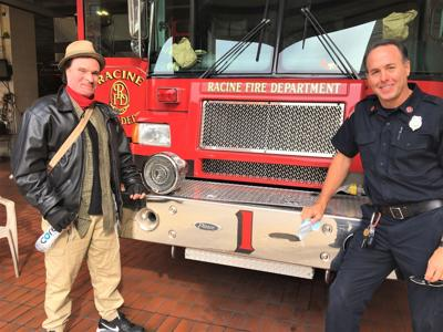 Fire survivor Joshua White and Capt. Craig Ford at Racine Fire Department Station 1