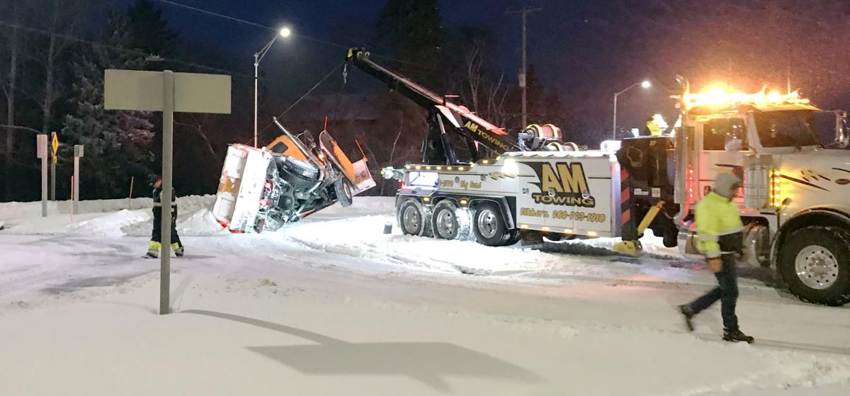 Tow truck loses control of disabled snowplow in Town of Norway