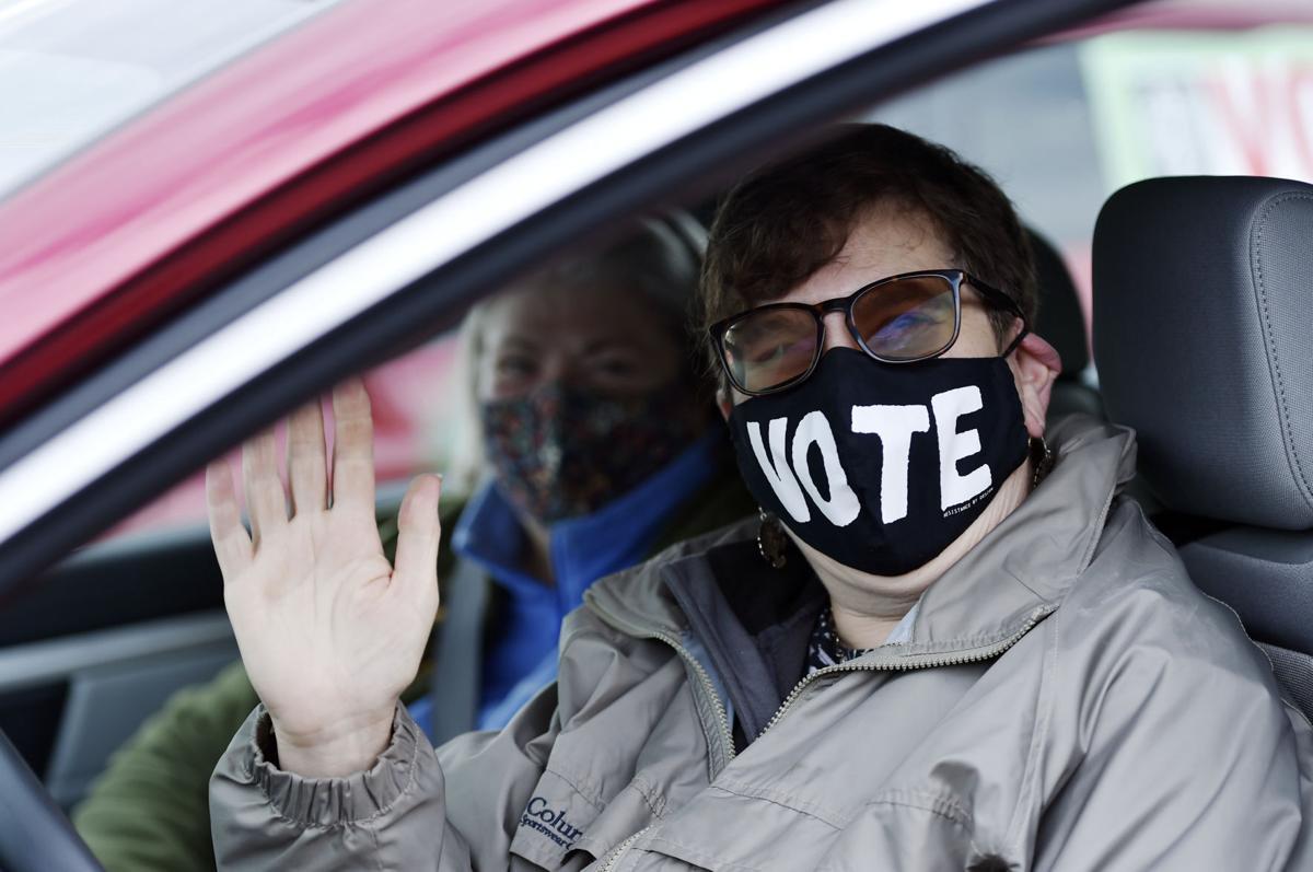 """Jean Brosseau rocks the """"VOTE"""" mask"""