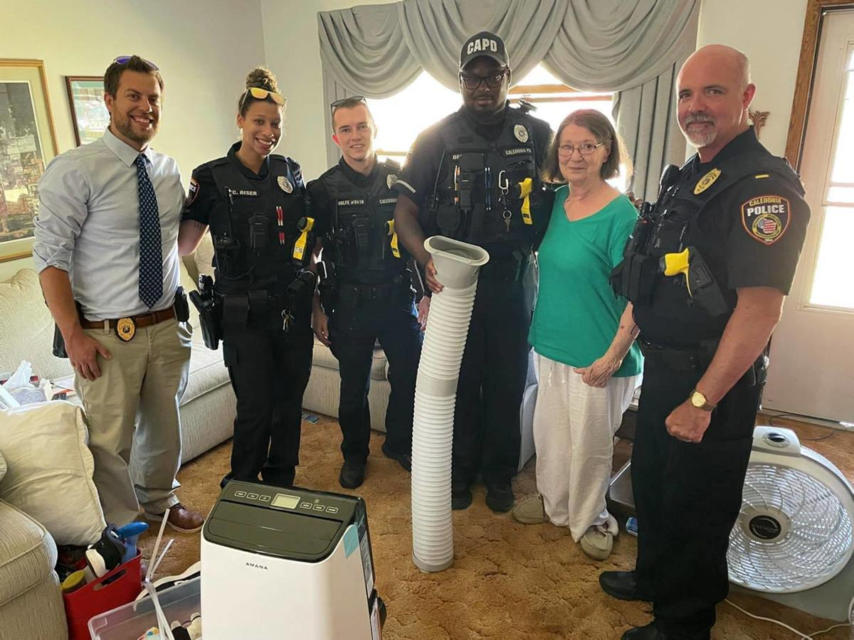 Caledonia Police Department poses with woman