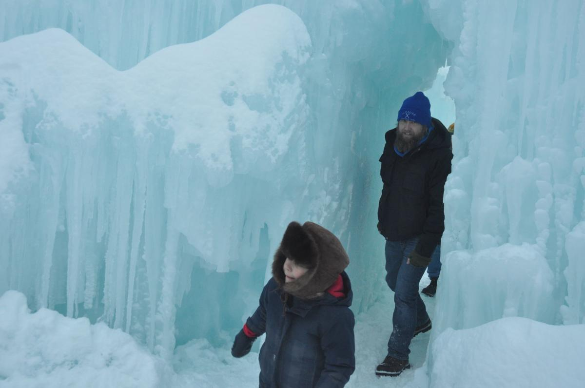 Spectators walk through the maze of the ice castle structure.