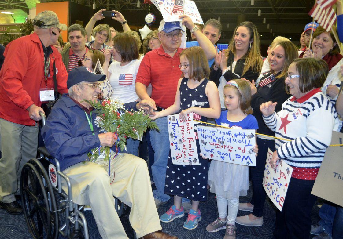 70366e847ea23 'I'll never forget this' -- Honor Flight warms hearts of World War II,  Korean War veterans