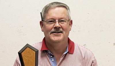 Tom Scheller with Angel Invitational trophy