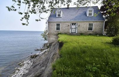 Home on eroding shoreline teeters into foreclosure
