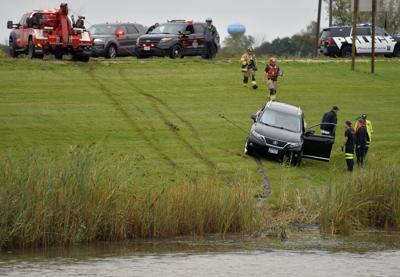 ACCIDENT VEHICLE IN POND
