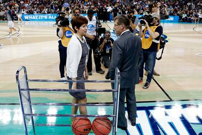 Head coach Muffet McGraw of the Notre Dame Fighting Irish (L) and head coach Geno Auriemma of the Connecticut Huskies meet prior to the start of the NCAA Women's Final Four National Championship at Amalie Arena on April 7, 2015 in Tampa, Florida. (Mike Carlson/Getty Images/TNS) *FOR USE WITH THIS STORY ONLY*