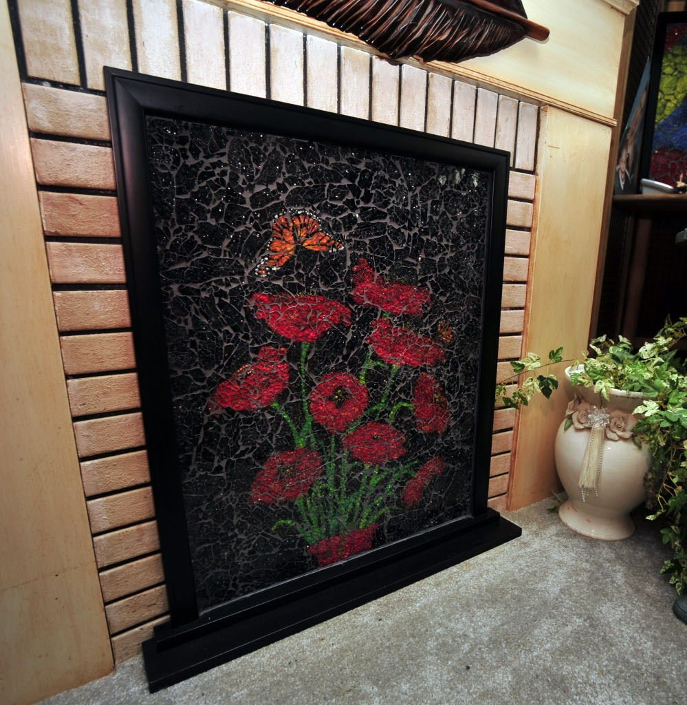 Local Artist S Shattered Glass Fireplace Covers Debut At Trade Show