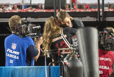 Tampa Bay Buccaneers quarterback Tom Brady receives a kiss from his wife Gisele Bundchen as the Tampa Bay Buccaneers celebrate their 31-9 win over the Kansas City Chiefs with his children in Super Bowl LV Sunday, February 7, 2021 in Tampa, Florida.