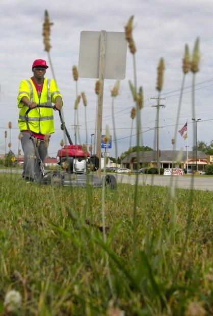 Inmates Cutting Grass