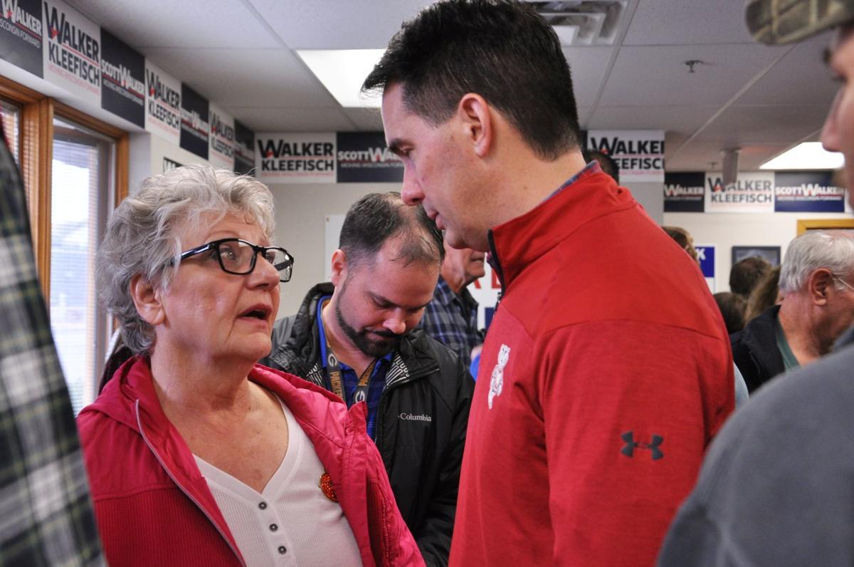 Walker visits GOP headquarters